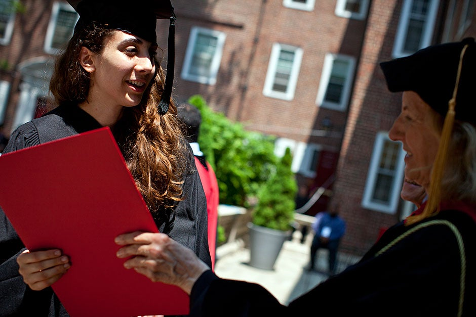 Julie Anne Arnous receives her degree at Kirkland House from House Master Verena Conley. Justin Ide/Harvard Staff Photographer