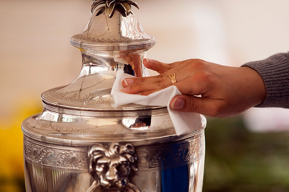 The Straus Cup is polished before the conferring of diplomas at Winthrop House. Brooks Canaday/Harvard University