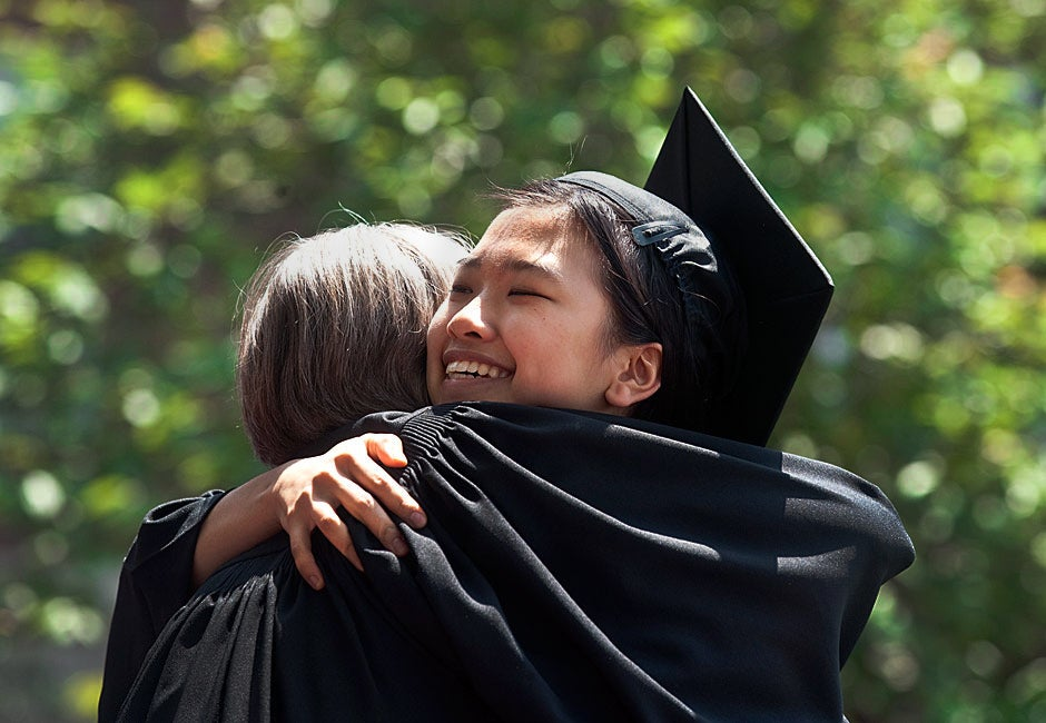 Susan Zhu '11 gets a congratulatory hug from Dunster House Co-Master Ann Porter at the House diploma ceremony.  Jon Chase/Harvard Staff Photographer