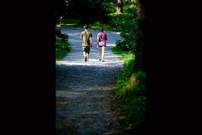 Lover's lane: A couple meanders through the Arboretum.