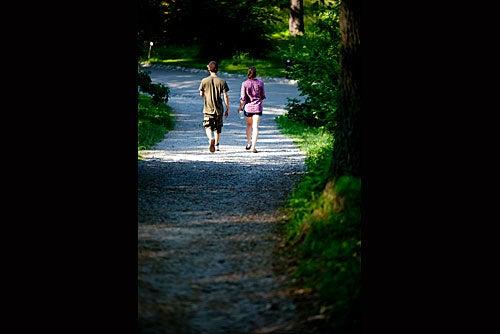 Lover's lane: A couple meanders through the Arboretum.