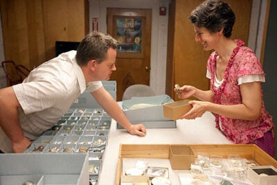 Patrick Degryse and Katherine Eremin examine Nuzi glass in the Semitic Museum's collections. The researchers are investigating the properties of ancient glass and other materials to understand more about where and how they were manufactured and what the background says about their makers.