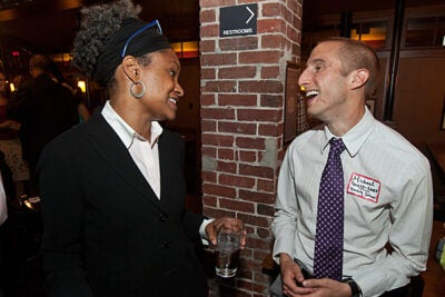 New Chief  Diversity Officer Lisa Coleman (left) met Michael Goetz from the Divinity School and co-chair of the LGBT Faculty and Staff Committee.