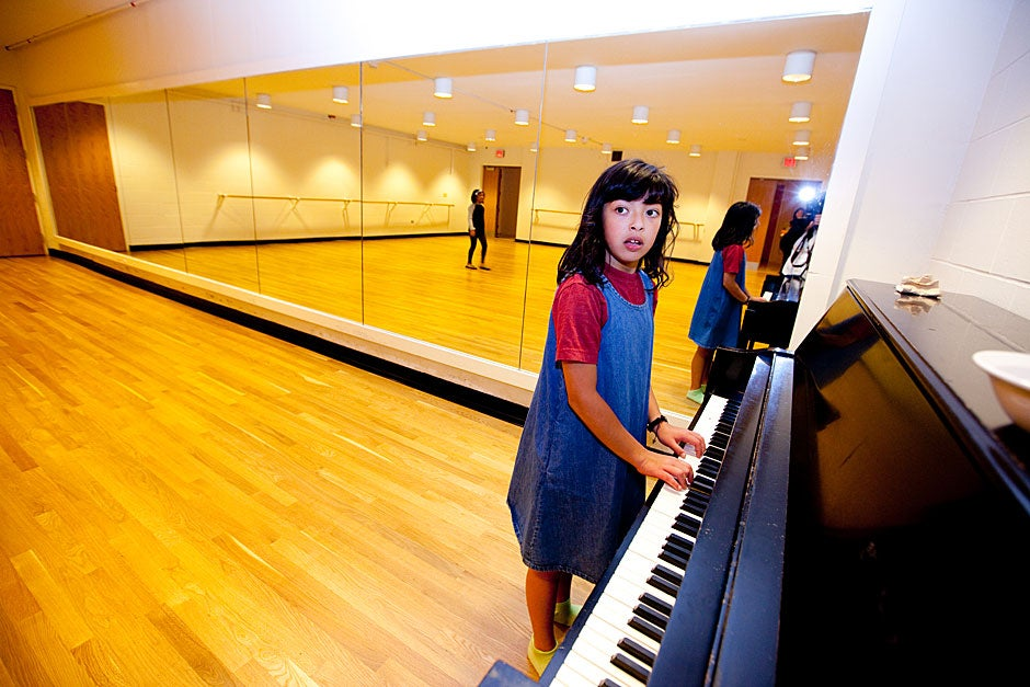 Mara plays the piano in the dance studio at Currier. Rose Lincoln/Harvard Staff Photographer
