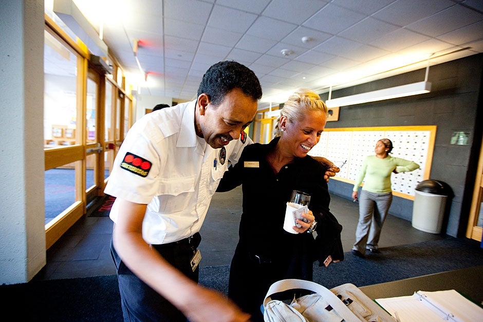 Patricia Machado (right) works in Dining Services at Currier House and is welcomed to work by Yohannes Tewolde. Rose Lincoln/Harvard Staff Photographer
