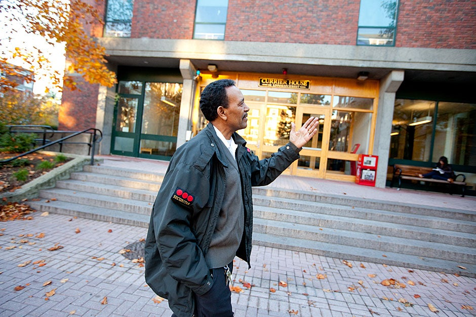 Yohannes Tewolde, the current and beloved night security guard at Currier, walks past the house entrance. Rose Lincoln/Harvard Staff Photographer
