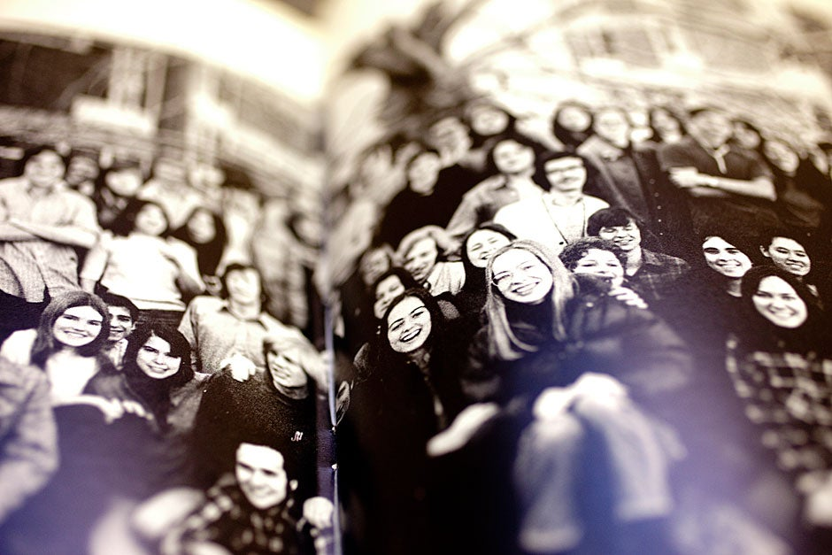 In 1972, full coeducational dormitories were instituted at Harvard — pictured here are the men and women of Currier House in a yearbook from the 1970s. Rose Lincoln/Harvard Staff Photographer