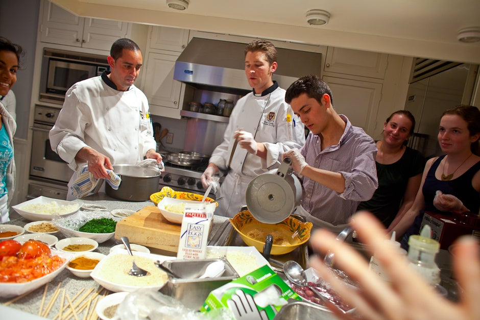 The Food Literacy Project at Harvard University hosted cooking classes in the Masters' residences in each of the Houses this semester. At Kirkland, House Masters Verena and Tom Conley gave up their kitchen to Executive Chef Brian Corcoran, Chef Luiz DaCosta, and 10 students. Justin Ide/Harvard Staff Photographer