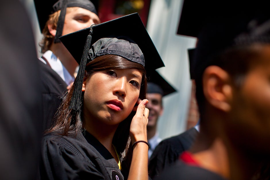 Amy Chen '11 fixes her hair as she waits in line at Kirkland House to get her degree. Justin Ide/Harvard Staff Photographer