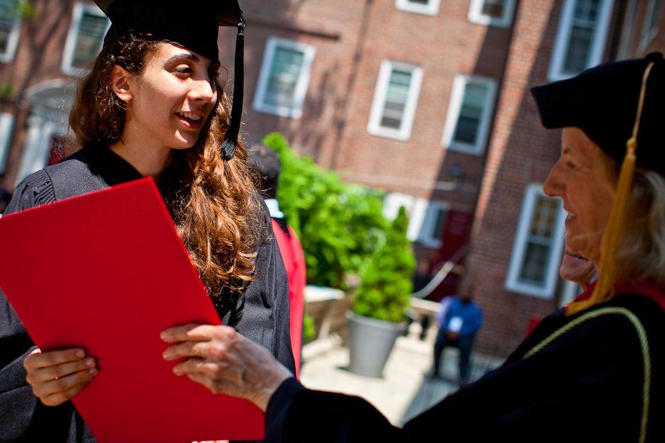 Senior Julie Anne Arnous gets her degree from Kirkland House Master Verena Conley. Justin Ide/Harvard Staff Photographer