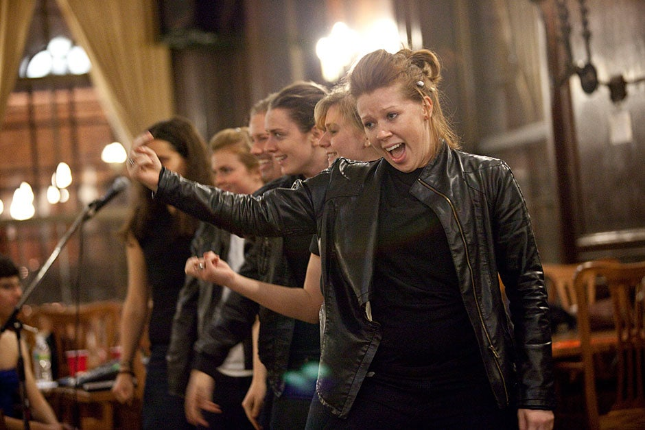 """Elyse Traverse '11 (front) belts a ditty from """"Grease"""" during Drag Night. Kris Snibbe/Harvard Staff Photographer"""