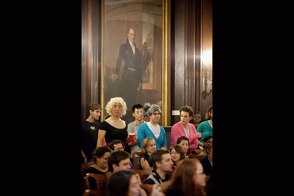 Who knew drag could be so regal? Under the austere art of Adams House, its resident men are dolled up like women. Kris Snibbe/Harvard Staff Photographer