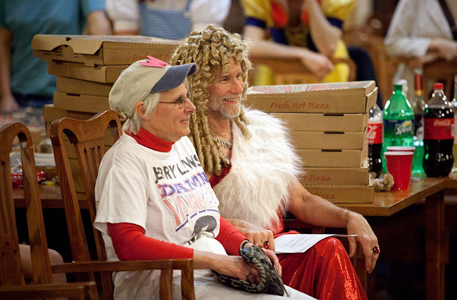 Amid towers of pizza boxes, Adams House Masters Sean and Judith Palfrey enjoy the performances. Kris Snibbe/Harvard Staff Photographer