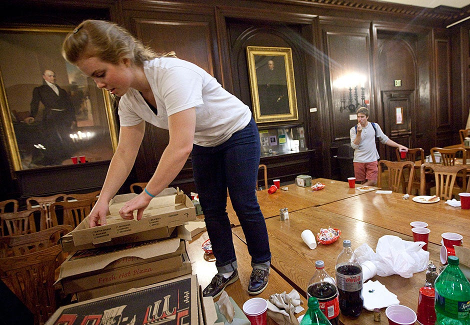 Sam Houston '11 cleans up the chaos. Kris Snibbe/Harvard Staff Photographer