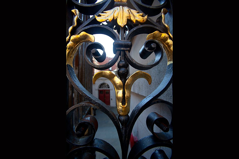 The entrance to Adams House is framed by an ornate gateway. Kris Snibbe/Harvard Staff Photographer