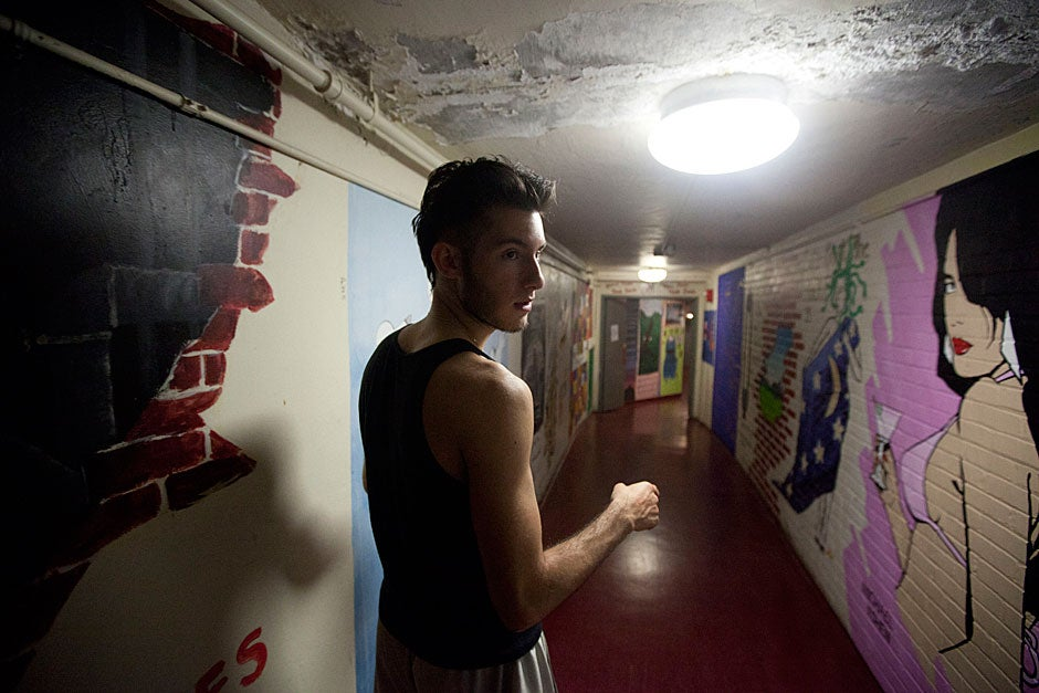 """George Zisiadis '11 prepares to paint a mock chart showing the relationship between the """"quality of your college experience and time spent looking at murals"""" in the tunnels. Kris Snibbe/Harvard Staff Photographer"""