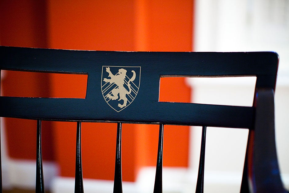 The Winthrop shield is painted on the chairs in the Senior Common Room. Stephanie Mitchell/Harvard Staff Photographer