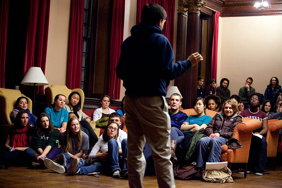 The audience listens closely as Brandon Seah '11 performs throat singing. Stephanie Mitchell/Harvard Staff Photographer