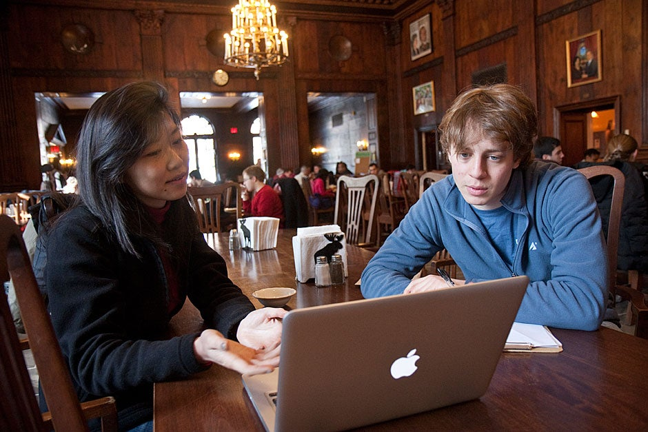 Diana Suen '11 and Michael Baskin '11 confer on a project over lunch in the dining room. In addition to being the place where students eat their meals, the dining room is also a gathering spot for students working or socializing at almost any time of day. Jon Chase/Harvard Staff Photographer