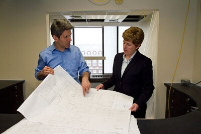 Ted Galante (left), an architect with Galante Architectural Studios, reviewed blueprints for the Campus Services Center back in May with Vice President for Campus Services Lisa Hogarty. The center is now open on the eighth floor of Holyoke Center.
