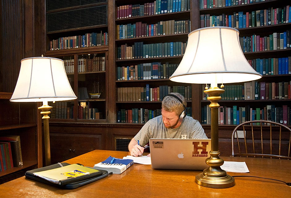 Garrett Barnard '13 finds some solitude for studying in the Dunster library on a weeknight. Jon Chase/Harvard Staff Photographer