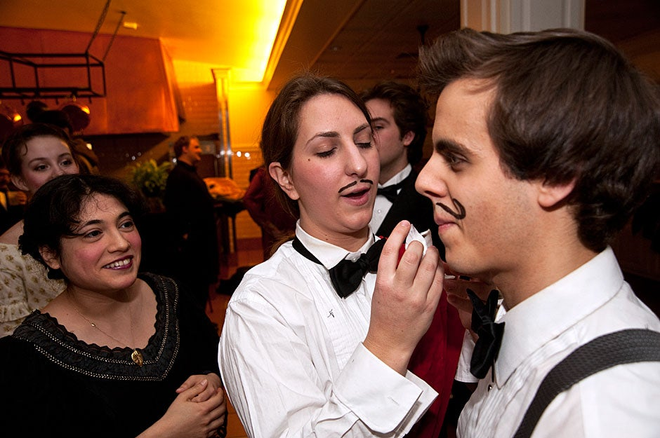"""Sofia Selowsky '12 applies makeup to Michael Cherella ' 11 before a performance of Johann Strauss' """"Die Fledermaus"""" by the Dunster House Opera Society. Jon Chase/Harvard Staff Photographer"""