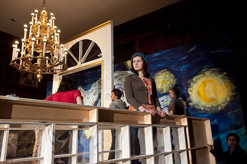 """The Dunster House Opera Society rehearses """"Die Fledermaus"""" by Johann Strauss. Allison Ray '14 looks out from the set while waiting for additional stagehands to arrive. Jon Chase/Harvard Staff Photographer"""