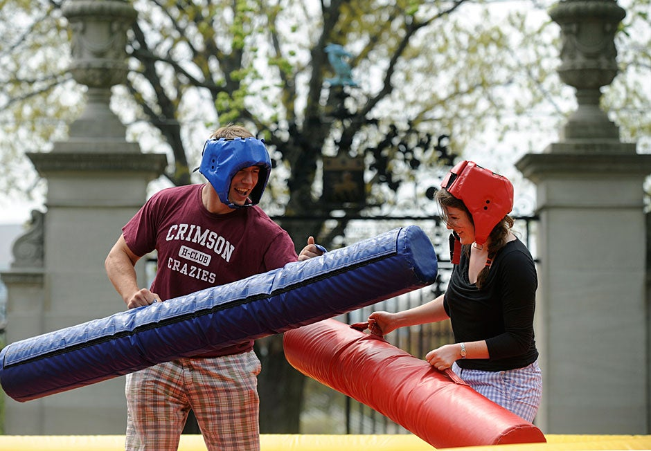 Rob Tennyson (left) jousts with Courtney Cronin '11 in the courtyard at one of many activities taking place during the annual Dunster House goat roast. Jon Chase/Harvard Staff Photographer