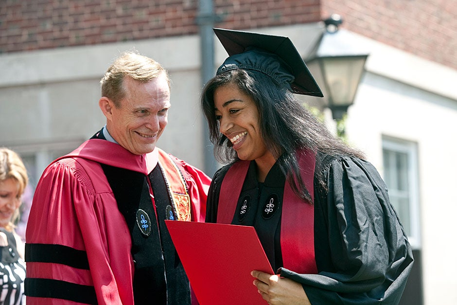 Tiffany Smalley '11 receives her diploma from Dunster House Master Roger Porter at the House ceremony during Commencement. Smalley is the first member of the Wampanoag tribe to graduate from Harvard College since Caleb Cheeshahteaumuck received his degree in 1665. Jon Chase/Harvard Staff Photographer