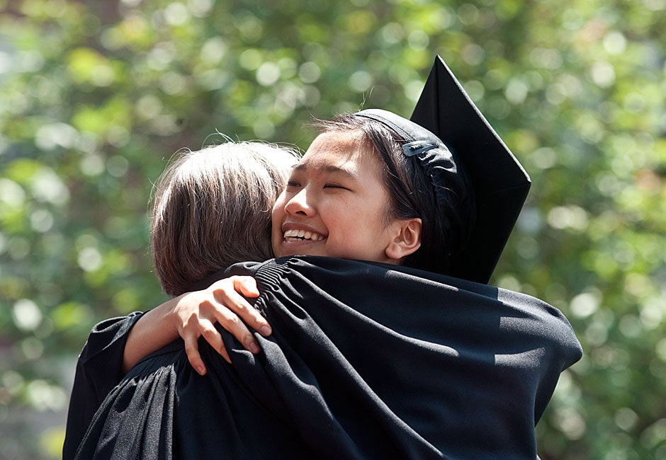 Susan Zhu '11 gets a congratulatory hug from Dunster House Co-Master Ann Porter at the House diploma ceremony on Commencement day. Jon Chase/Harvard Staff Photographer