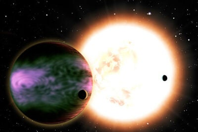 "This artist's conception shows a ""hot Jupiter"" and its two hypothetical moons with a sunlike star in the background. The planet is cloaked in brilliant aurorae triggered by the impact of a coronal mass ejection. Theoretical calculations suggest that those aurorae could be 100-1,000 times brighter than Earth's. Credit: CfA"