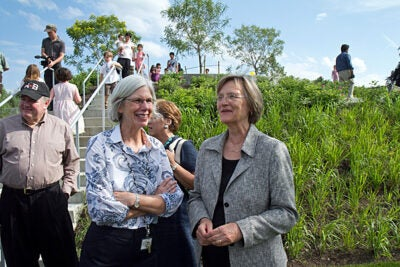 Harvard President Drew Faust (from right) speaks with Amy Ryan, president of the Boston Public Library, following a ribbon-cutting ceremony that marked the dedication of Library Park at the Honan-Allston Branch of the Boston Public Library. State Rep. Kevin Honan (far left) joined in the festivities.