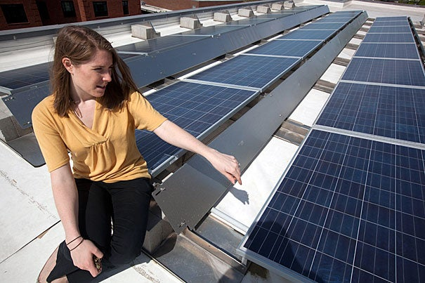 HGSE project manager and Green Team member Linda Kuczynski shows off solar panels on the roof of the Gutman Library. Other targeted initiatives at the School include a printer cartridge recycling program, a cosmetics drive, bike rack improvements, and, coming soon, single-stream recycling and public composting.