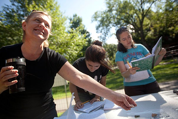 "Students Colleen Skipper (from left), Julie Boshyk, and Cristina Monfasani record their findings during the Summer School's Yard dig program's ""results day."""