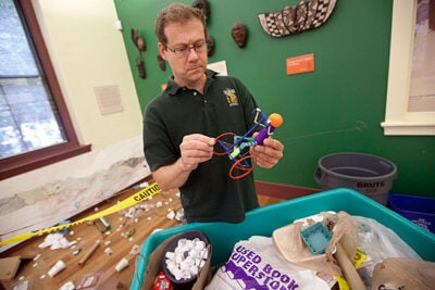For a few weeks, Peabody Museum education specialist Andrew Majewski had museum staff members compile a supply of cleaned trash to be fashioned into toys, bringing in items from home.