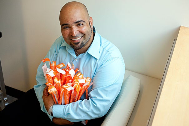 Joel Rivera-Cardona, manager of procurement services at the Wyss Institute, uses the Harvard Crimson Online Marketplace to purchase everything from chairs to rare, hard-to-source materials.