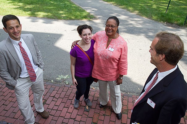 Evelynn M. Hammonds (center right), dean of Harvard College, offered a warm welcome to Amalia Duncan '15. Dean of Freshmen Thomas A. Dingman (far right) Ben Castleman, (far left) were also on hand as the Class of 2015 streamed into Harvard Yard on Thursday.