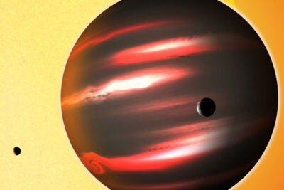 The distant exoplanet TrES-2b, shown here in an artist's conception, reflects less than 1 percent of the light that falls on it, making it blacker than any planet or moon in our solar system.