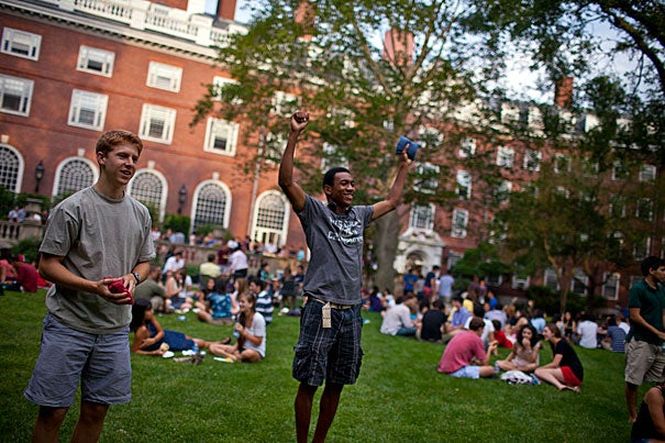 "Ben Enowitz '12 (from left) and Wes Mann '13 play ""cornhole"" on the lawn during Eliot House's welcome back barbecue."