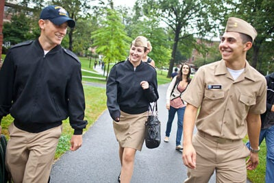 Midshipmen Colin Dickinson '13, Catherine Philbin '14, and Sebastian Saldivar '15 make their way to class on Harvard's campus.