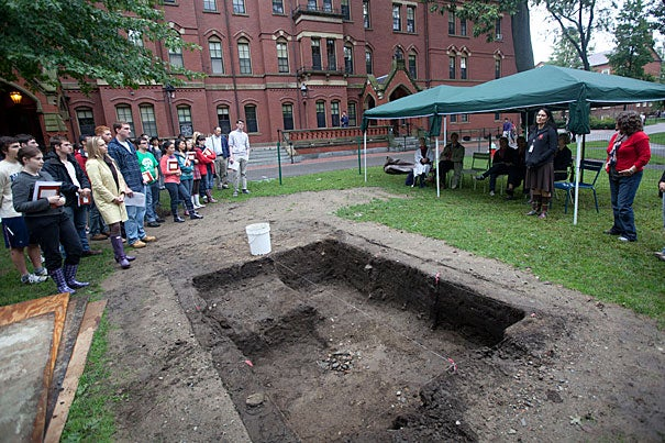 "Students, faculty, and Native American tribal representatives gathered to officially kick off the fall archaeology season in Harvard Yard Sept. 8. ""It's not just a Harvard story; you're telling a tribal story,"" Shelly Lowe (left, under tent), executive director of the Harvard University Native American Program, said."
