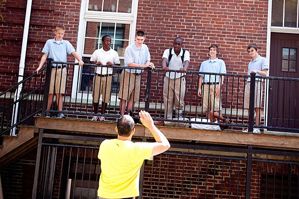 "Osh Ghanimah (foreground), a first-year student at the American Repertory Theater/MXAT Institute for Advanced Theater Training, works with high school sophomores Stephen O'Brien (from left), Anwar Sabir, Jerry Manning, Mark McCalman, Eamonn Mannion, Alex Sorel, and Jordyn Mattier (lying down) at the Boston Collegiate Charter School in Dorchester to develop new songs based on works in ""Porgy and Bess."""