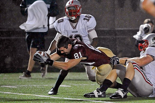 Harvard wide receiver Adam Chrissis '12 loses his helmet but stretches to place the ball over the goal line. Officials ruled, however, that Chrissis had trapped the ball and returned it to the 2-yard line. Harvard won, 24-7.