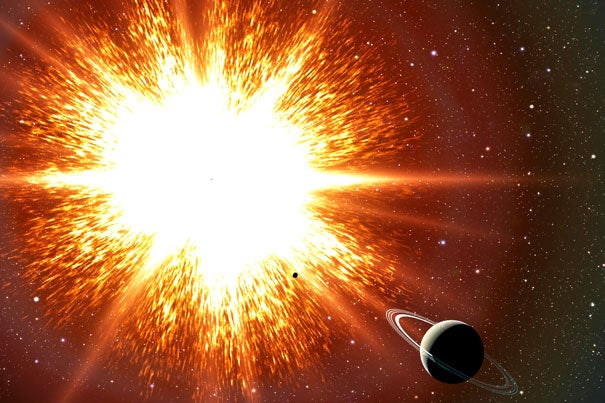 "New research shows that some old stars, known as white dwarfs, might be held up by their rapid spins, and when they slow down, they explode as Type Ia supernovae. Thousands of these ""time bombs"" could be scattered throughout our Galaxy. In this artist's conception, a supernova explosion is about to obliterate an orbiting Saturn-like planet."