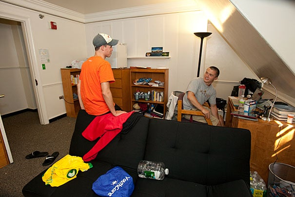 """It's cool,"" Tom Keefe '15 (left) said of his new abode. ""There are only 14 kids, there's amazing history, and we are on the top floor."" He and new roommate George Doran '15 already had bonded over common interests, including a Nintendo 64 video game and the need for a tall floor fan, which they purchased right after they moved in."