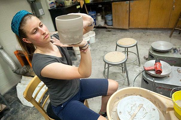 Caroline Lowe '12 works in the Mimi Aloian Pottery Studio.