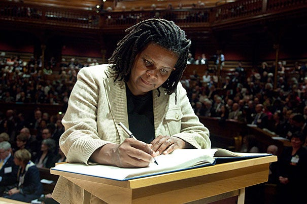"Among the inductees was Annette Gordon-Reed, pictured signing the book. ""Induction recognizes extraordinary individual achievement and marks a commitment on the part of new members to provide fundamental, nonpartisan knowledge for addressing today's complex challenges,"" said the academy's President Leslie C. Berlowitz."