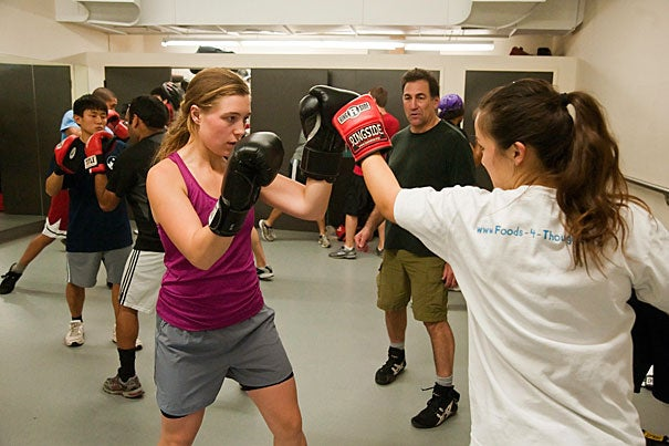 "At practice, women do the same exercises as their male counterparts — 100 reps of sit-ups and push-ups, punching bag drills, and more. ""Forget about the boxing aspect for a moment,"" said Susan Seav '12 (not pictured). ""A lot of girls join the club just to get a good workout, and to find a buddy who understands the pain."""