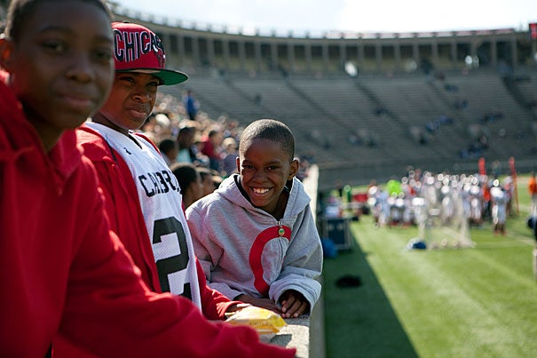 Taking part in Harvard's annual Community Football Day were (from left) Jamal Peters, 13, Kyree Johnson, 12, and Saheim Jackson, 8. The Cambridge youngsters were among the 1,000 or so community residents invited to the Crimson football game on Oct. 15.
