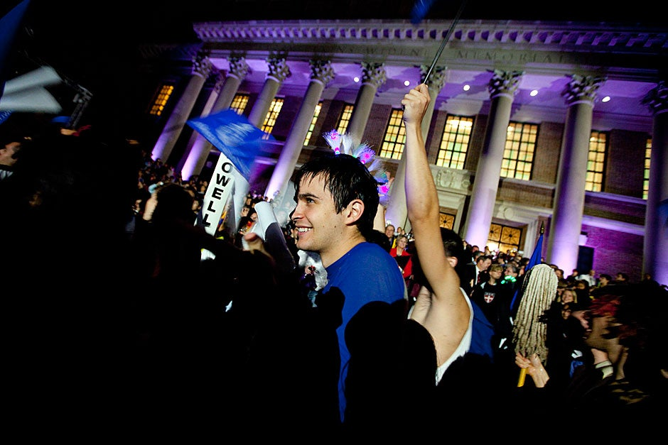Lawrence Cripe '13 of Lowell House parades past Drew Faust and other reviewers. Rose Lincoln /Harvard Staff Photographer